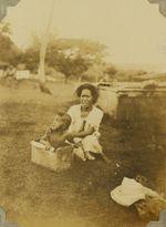 Tongan mother bathing a child in a kerosene tin, 1928